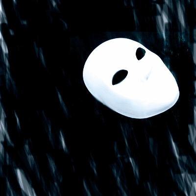A highly stylized mask is shown against a black background. The eyes are empty.